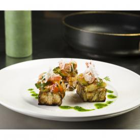 Melanzane con Ratatouille di verdure, scampetti arrostiti, cacioricotta e dressing al cavolo nero